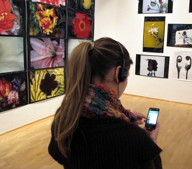 Fig 6: A visitor using the catalogue on iPhone as interactive guide at the Araki exhibition
