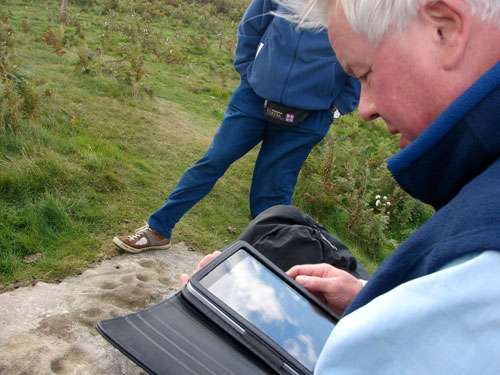 Figure 12. Participant using own iPad during Lordenshaw site visit (Rothbury, Workshop 2)